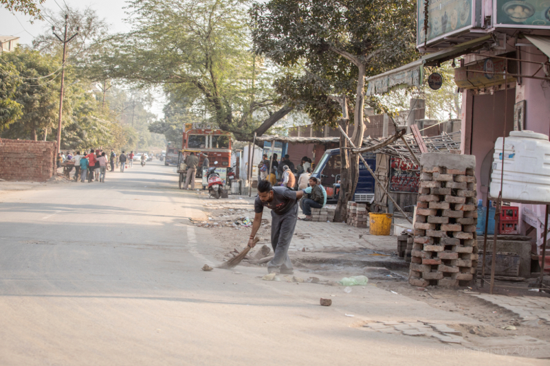 Sweeping the street, Agra, Uttar Pradesh, India