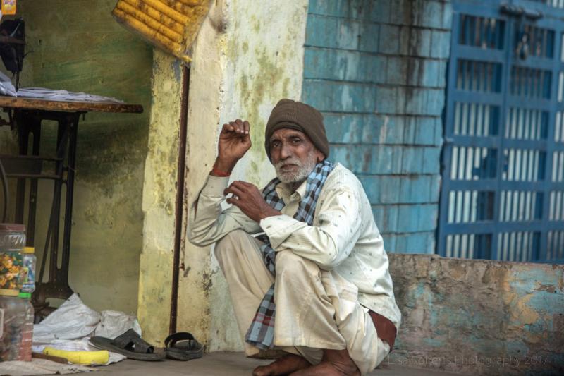 Man crouching, Agra, Uttar Pradesh, India