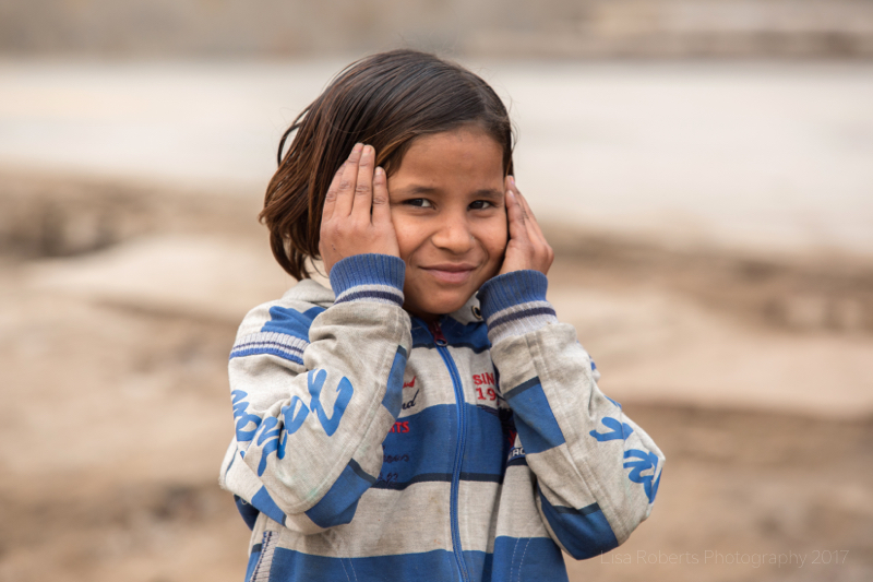 Girl with hands on her face, Mathura, Uttar Pradesh, India