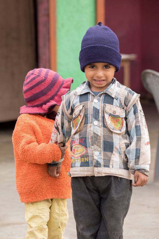 Boy & girl with pink hat, Mathura, Uttar Pradesh, India