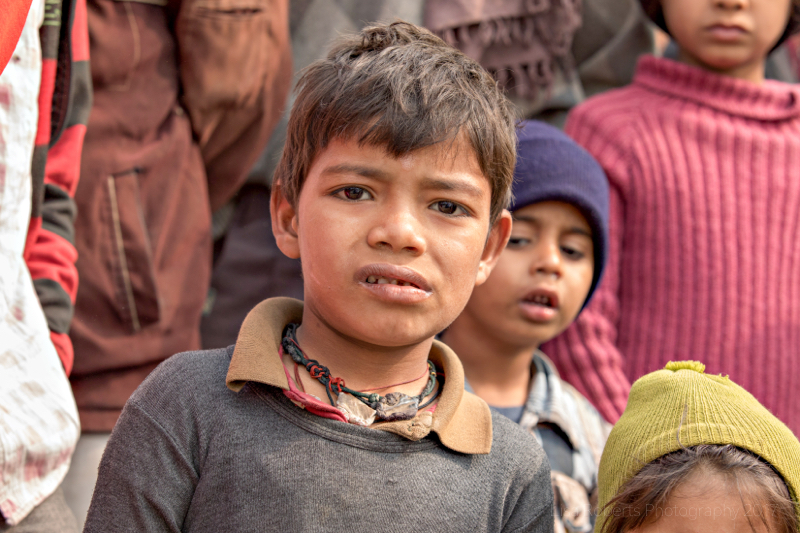 Curious boy, Four children, Mathura, Uttar Pradesh, India
