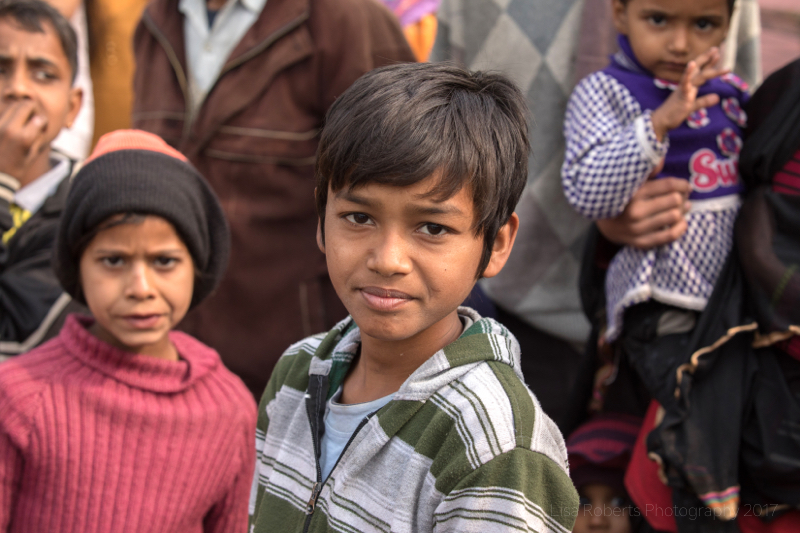Boy in green & white striped top, Mathura, Uttar Pradesh, India