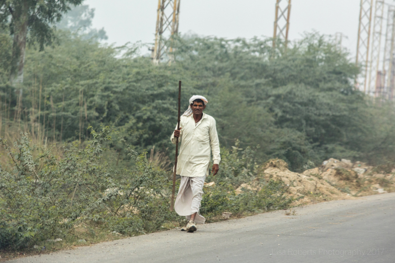 Man walking with stick, Chhata, India