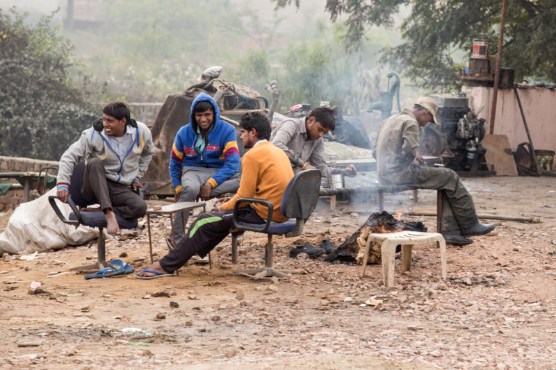 Men chatting by the fire, Kosi Kalan, India