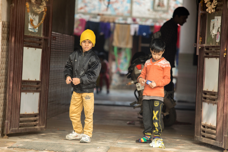 Two boys in doorway, Palwal, India