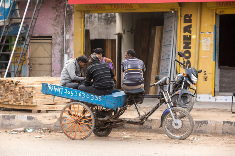 Four men and a tricycle, Gargaon, Haryana, India