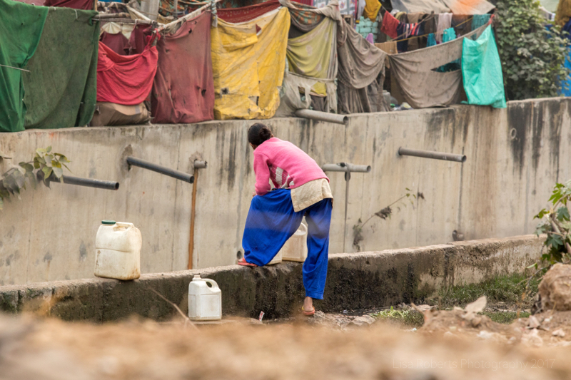 Woman in pink in New Delhi Slum, India