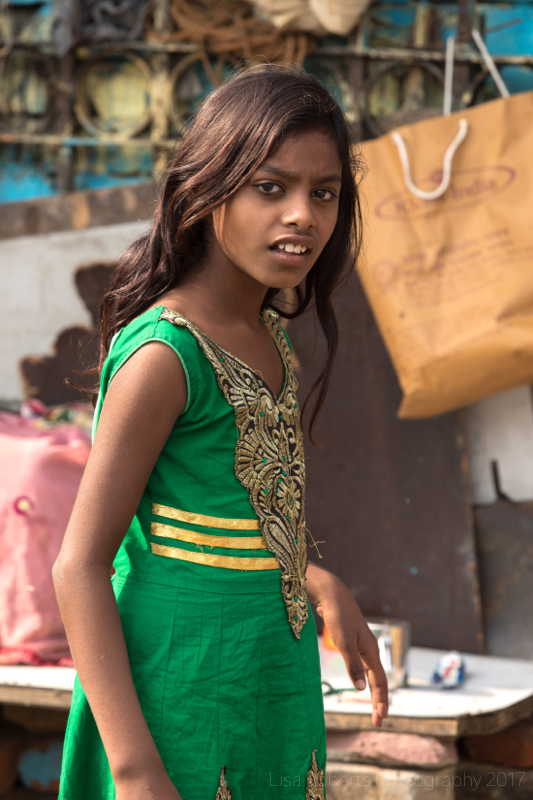Girl in green, Street slum, New Delhi, India