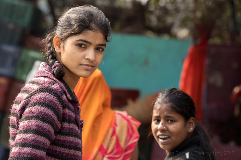 Girls looking, New Delhi street slum, India