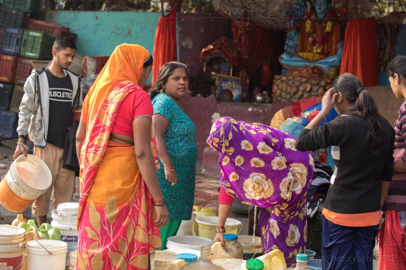 Busy women, New Delhi street slum, India