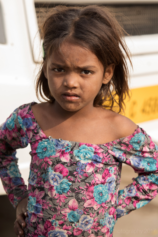 Girl in flowery dress, New Delhi street slum, India