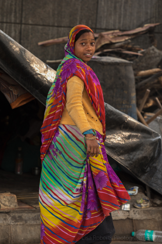Woman in colourful sari, New Delhi street slum, India