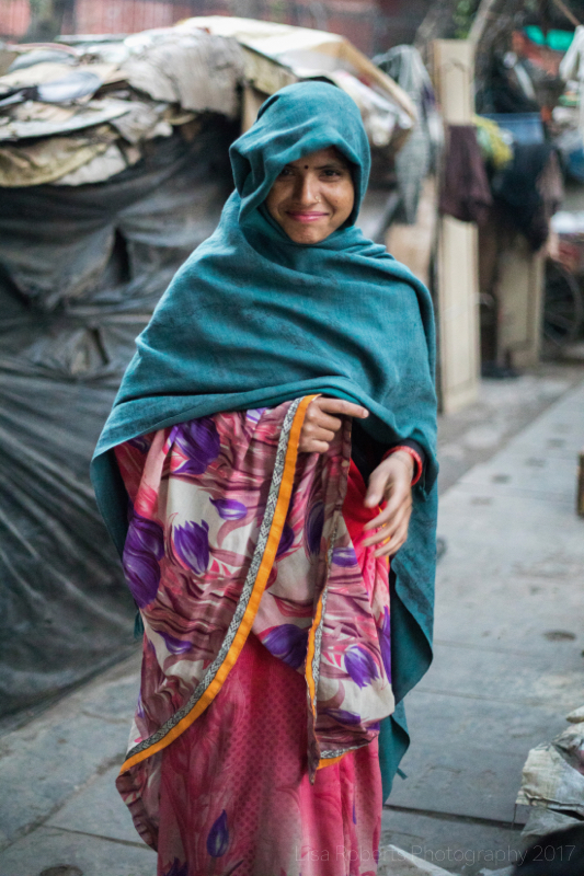 Woman in blue sari, New Delhi street slum, India