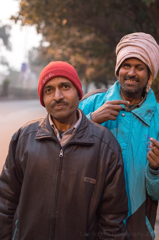 Men in beanie hats, New Delhi street slum, India