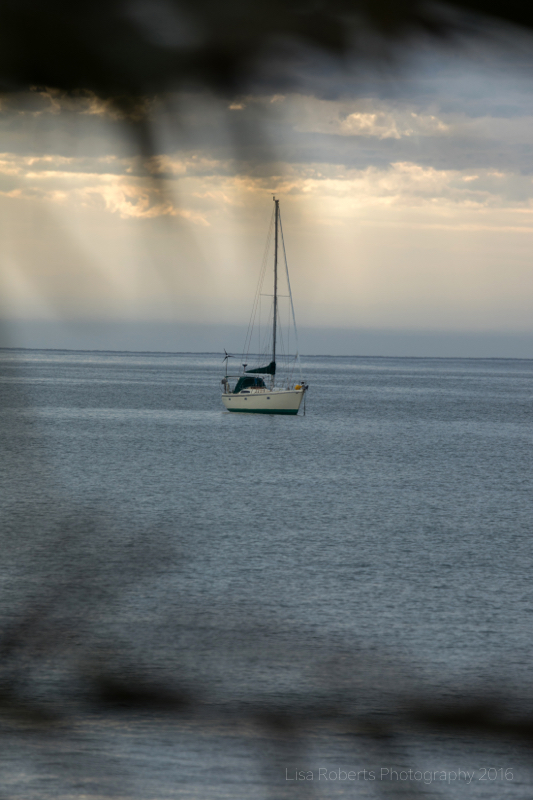 Yacht at sundown, Twofold Bay, Eden, NSW Australia