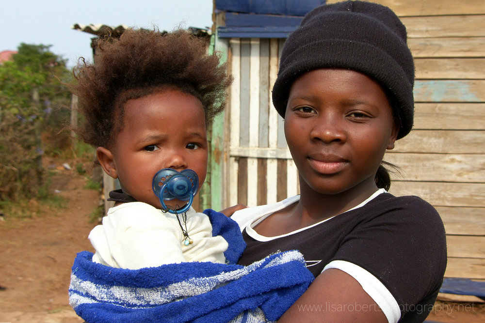 Girl and baby in local Village, Eastern Cape, South Africa