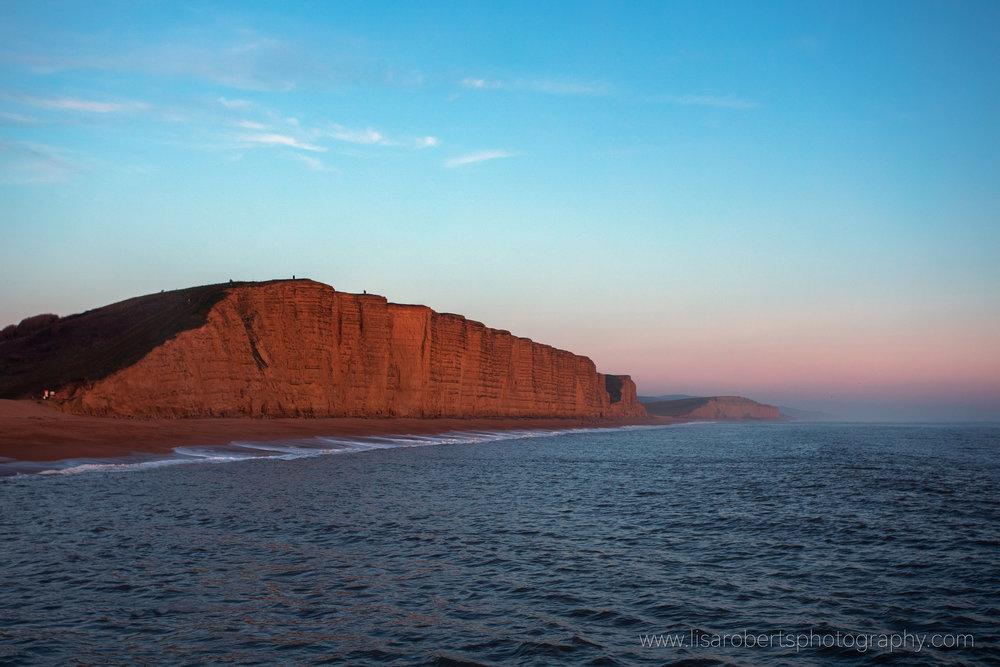 Cliffs at sunset, West Bay, Dorset, England