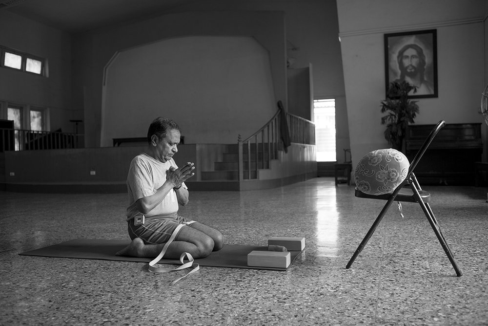 """Fr. Joseph H. Pereira practicing Iyengar yoga 2 Church of Our Lady of Mount Carmel, Mumbai 