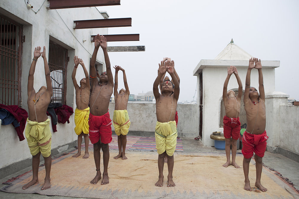 "Ashtanga Yoga Students practicing Surya Namaskara International Chandramauli Charitable Trust, Varanasi | Archival Pigment Ink on Hahnemühle FineArt Photo Rag Paper | 11""  x 16.5"" | 2016"