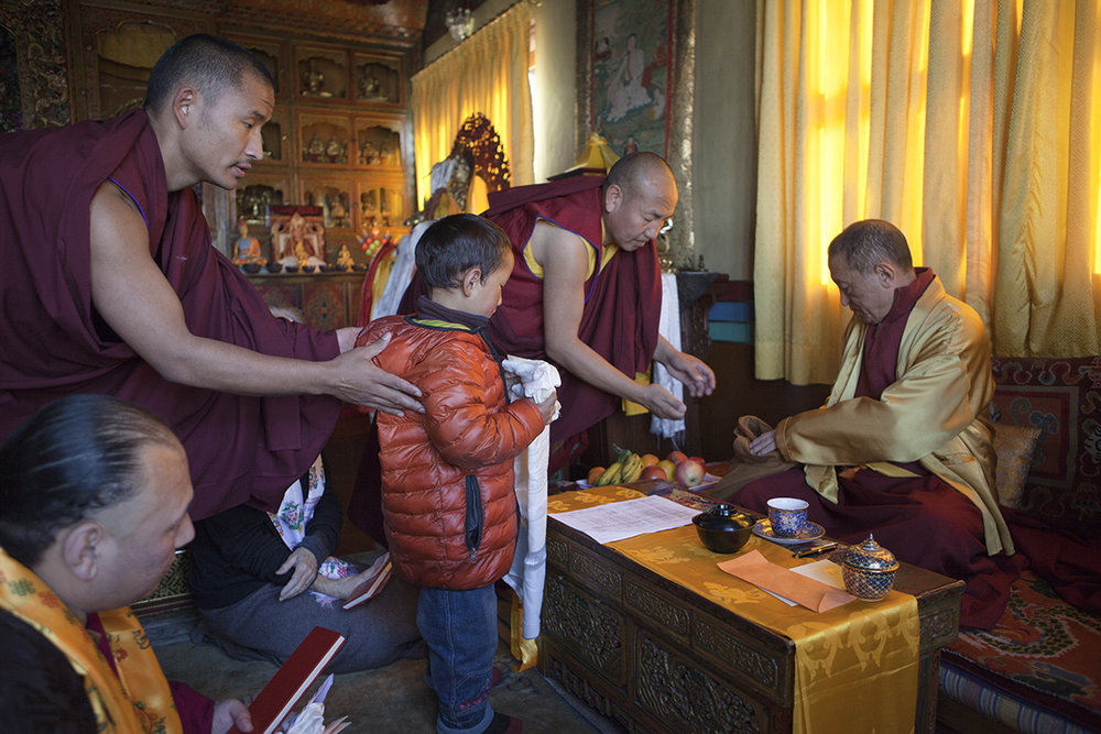 """Chokyi Nyima Rinpoche with a young boy upon his initiation into monkhood Ka-Nying Shedrub Ling, Kathmandu, Nepal 