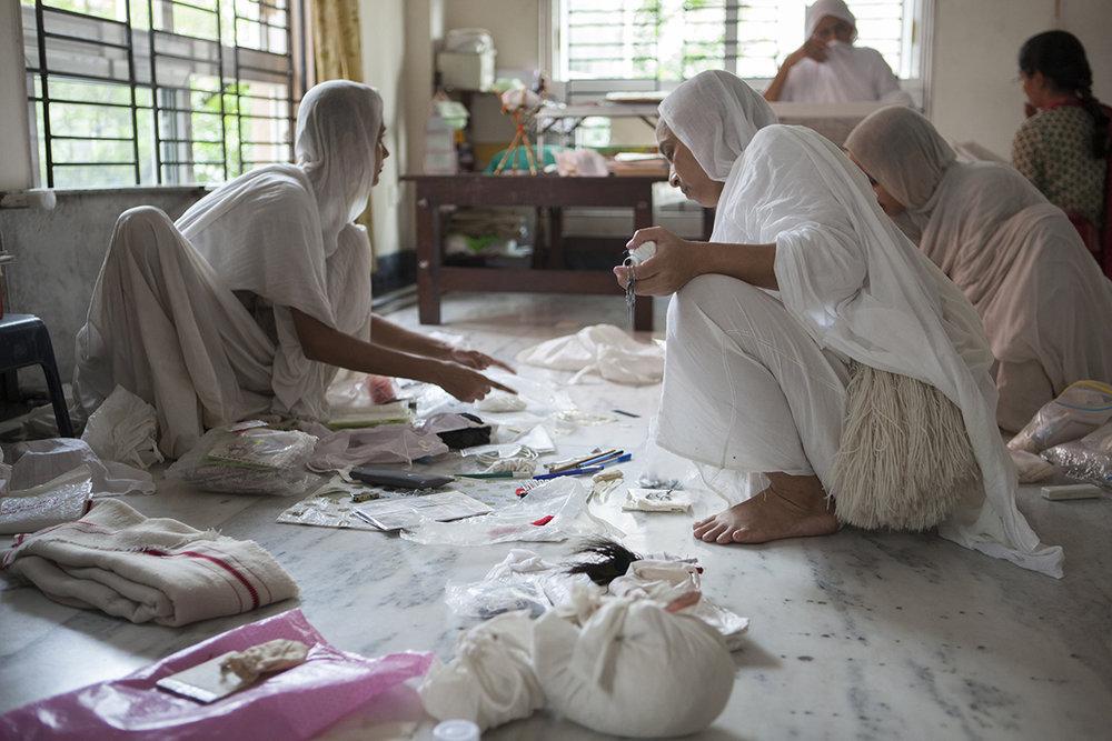 "Swetamber Jain nuns sorting through the last possessions Kolkata | Archival Pigment Ink on Hahnemühle FineArt Photo Rag Paper | 11"" x 16.5"" | 2015"