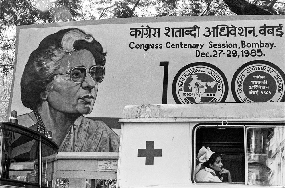 "Nurse and poster of Indira Gandhi at the Congress Centenary Session Bombay 1985 | Archival pigment print | 24"" x 35"""