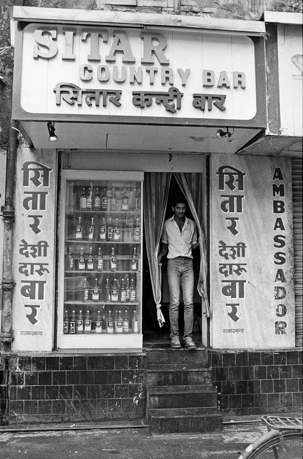"Sitar country liquor bar Bombay 1986 | Archival pigment print | 35"" x 24"""