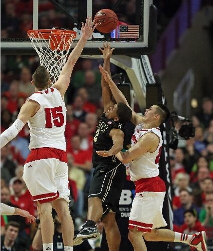 Wisconsin foul in the back on PJ