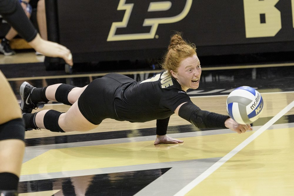 Maybe she is doing a one-handed pushup while digging an attack that's inches from the court. Is libero Spanish for superhero?