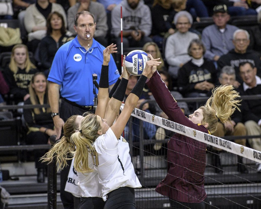Purdue was able to stifle the Minnesota attack again and again; here, Mohler and probably Newton hold off a Gopher attempt.