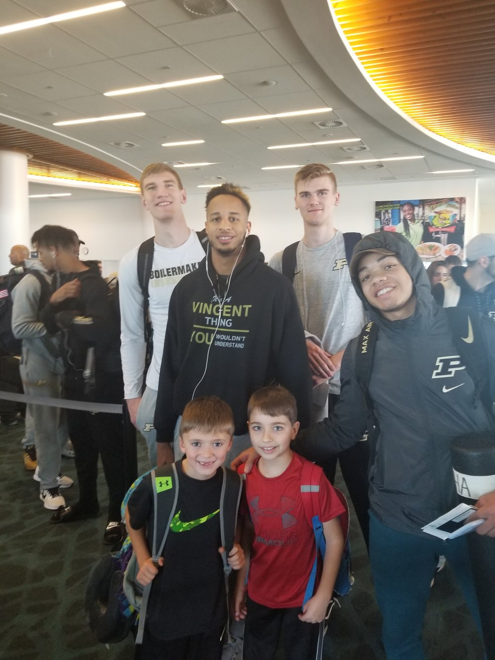Purdue bball at airport.jpg