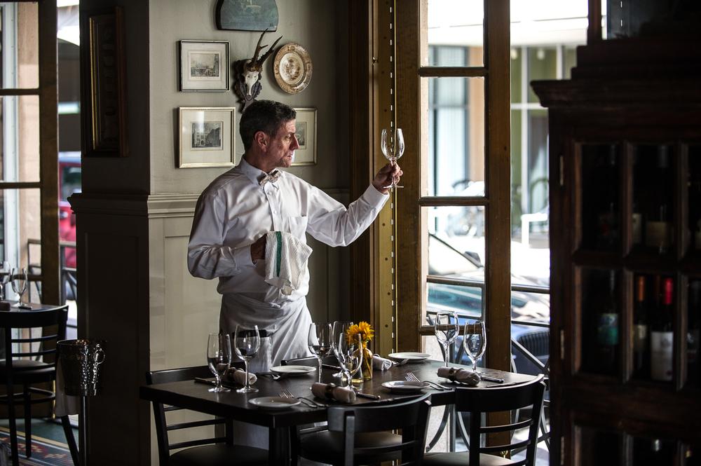 Barony Tavern - Waiter Cleaning Wine Glassjpg
