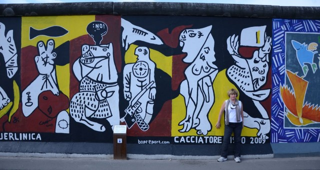 Egos put up walls between us. The Arts break them down. (Me at The Berlin Wall)