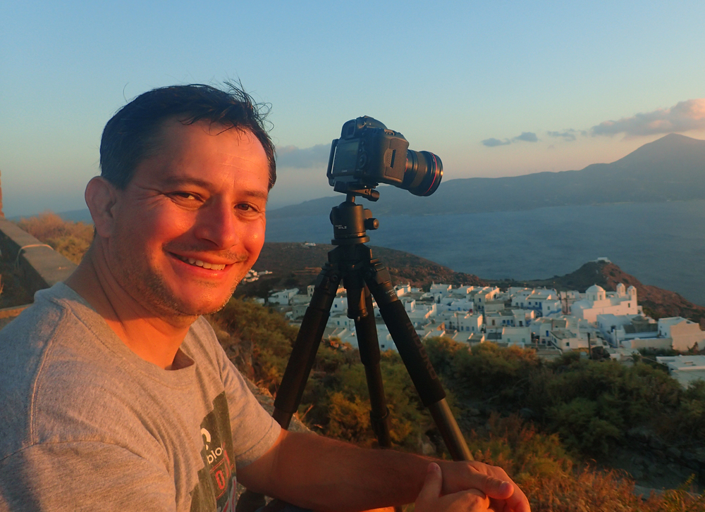 Yours truly while enjoying a wonderful sunset in the island of Milos, Greece.