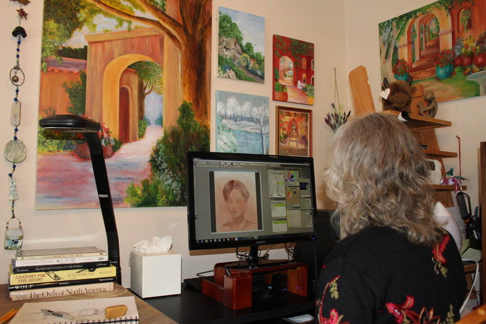 In my studio painting with Corel Painter 2017. The paintings on the wall are my acrylics.