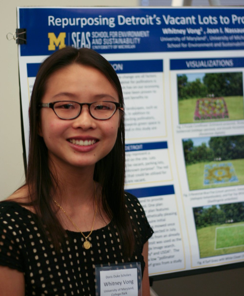 2017 Scholar, Whitney Vong, presents her poster at the annual DDCSP Research Symposium. Photo Credit: Yorick Oden-Plants
