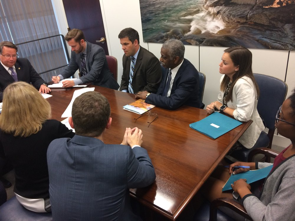 2016 Scholar, Danielle Moni-Zo'obo (far right), joins a meeting with U.S. Senator Gary Peters as part of her 2017 summer internship with the Michigan League of Conservation Voters.