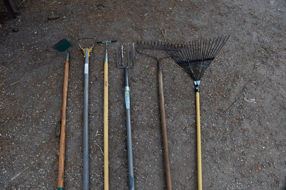 Left to right 1.      Garden/flower hoe- good for loosening soil and taking out weeds and old plants, not good for weeding in between plants 2.      Action/hula/stirrup hoe- convenient for weeding, uses a back and forth motion 3.      Collinear hoe- good small weeds and precise weeding; just scrape the surface to disrupt their roots and the weeds will die 4.      Fork- can be used to pull up weeds roots so they are easier to pull out without breaking 5.      Garden rake- used to rake up weeds, has wider teeth 6.      Fine rake- used if there are many small weeds