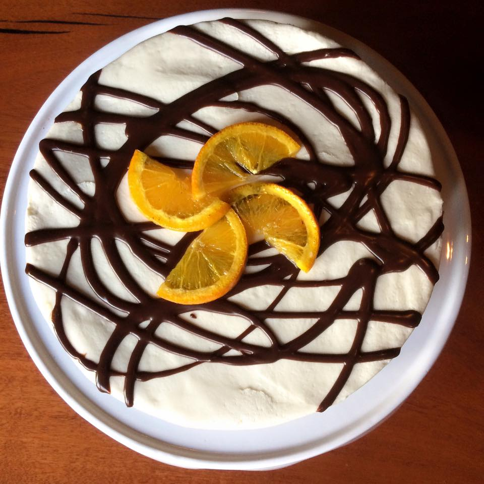 Grand Marnier Cake | $55   (16 Slices)  Chocolate Cake covered in Grand Marnier Buttercream Frosting, Chocolate Ganache and Oranges.