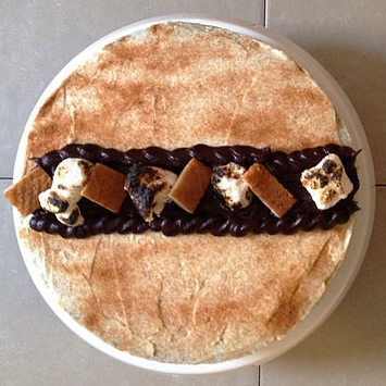 S'mores Cheesecake | $46   (16 Slices)  Madagascar Vanilla Bean Cheesecake baked on a homemade Graham cracker crust, topped with chocolate ganache and toasted marshmallow fluff.
