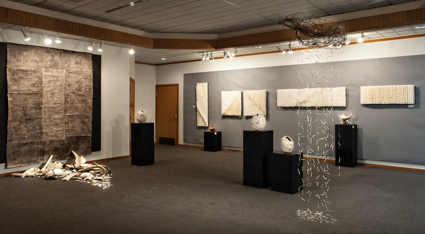 Installation view     Tears for the World      2014    Orcas Center Gallery, Orcas Island, WA     Shorelife/Ebbtide , (left, on floor)        Tears for the World    2014    fired clay,  found wire object, string    (right, suspended from ceiling)