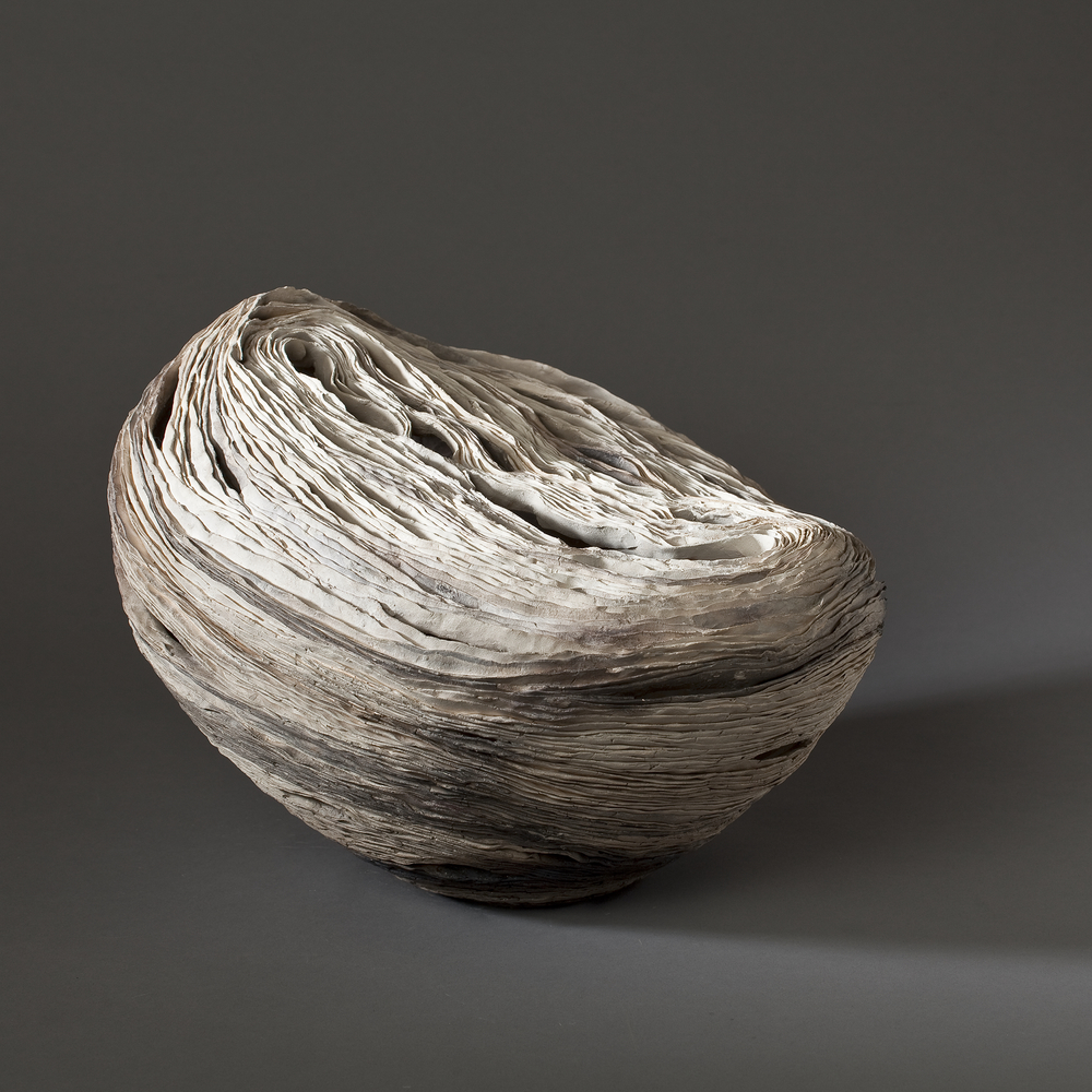 "Half Moon Reclining  2009    clay, kiln-and pit-fired    10""h. x 13"" x 12"""