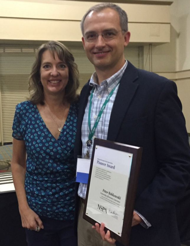 Assistant Professor Peter Bobkowski received the Pioneer Award at the National High School Journalism convention.