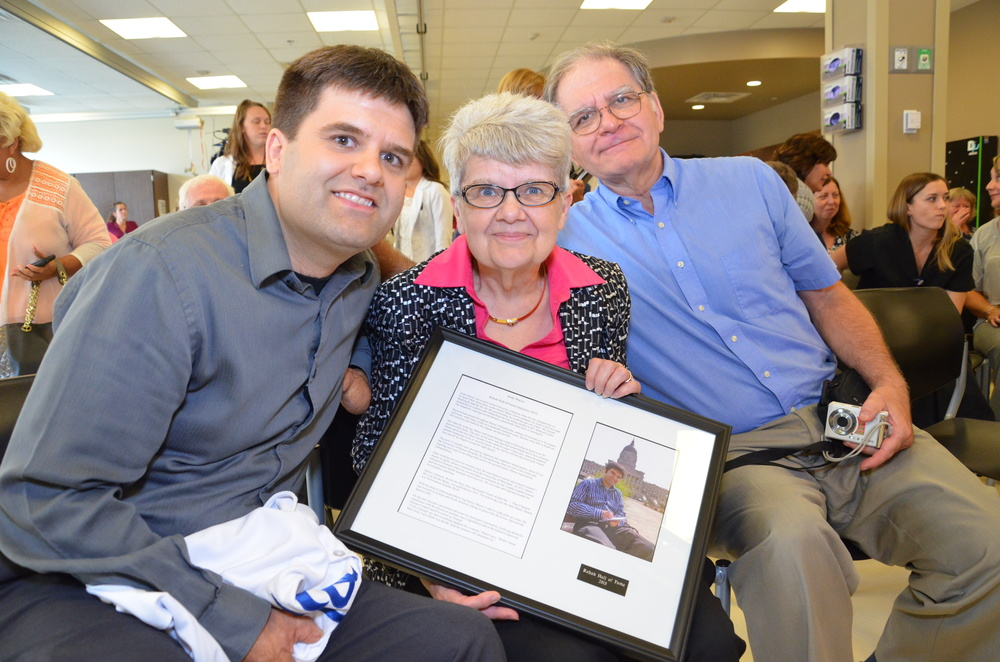 Andy Marso (left) with his parents at his Rehab Hall of Fame induction.