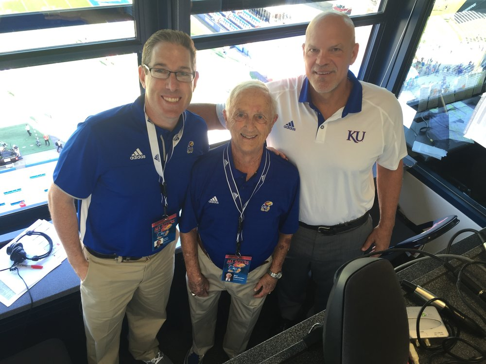 Brian Hanni, (from left) Max Falkenstien (former Voice of the Jayhawks, 1946-2006) and David Lawrence (football color analyst for the Jayhawk Radio Network, former KU offensive lineman) posed for a photo before a Kansas football game.