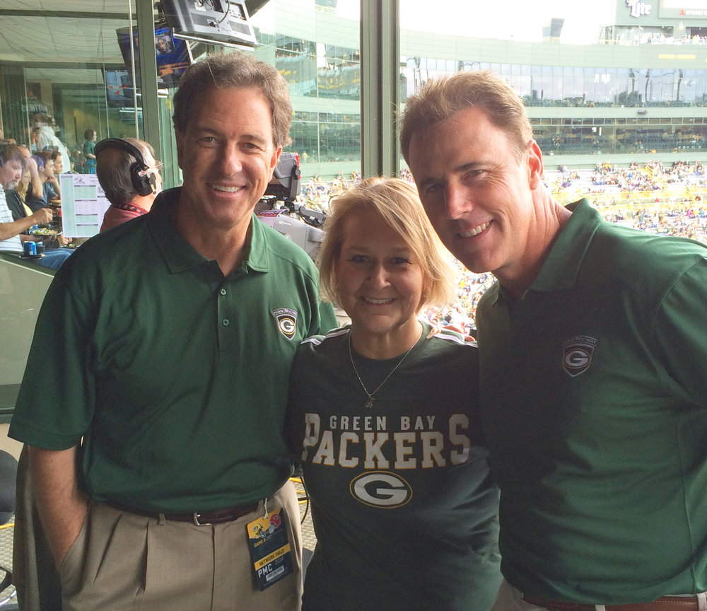 Harlan with J-School Dean Ann Brill and sports commentator Rich Gannon at Lambeau Field in Green Bay, Wisconsin.