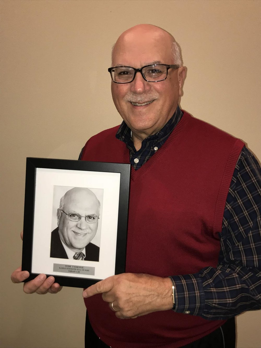 Tom Throne  (j'72, above) was inducted into the Kansas Newspaper Hall of Fame by the Kansas Press Association earlier this year. Throne has held leadership roles at six different newspapers in three states. He and his wife, Pam, are retired and live in Bentonville, Arkansas.
