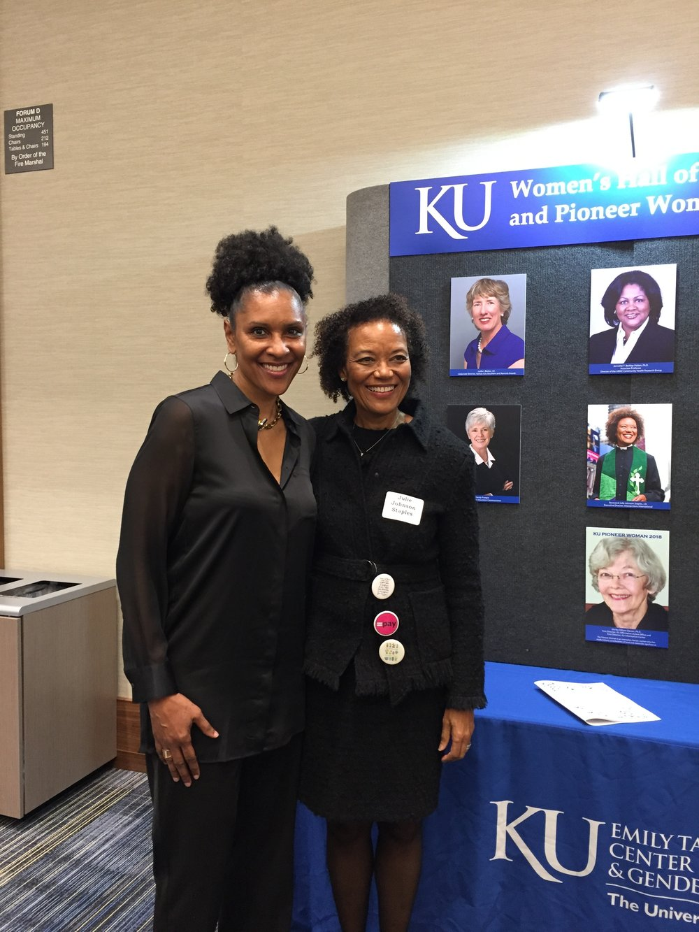 Julie Johnson Staples  (j'78) was inducted into the KU Women's Hall of Fame in April. Staples (right) is pictured with  Lynette Woodard  (c'81 left), who also was inducted. Staples is executive director of Intersections International in New York City. She recently served as interim senior minister of the 116-year-old Flatbush-Tompkins Congregational Church in Brooklyn, New York. As a KU student, she was the first African-American editor of the University Daily Kansan. She eventually became the White House correspondent for the Baltimore Sun and The New York Times. In 1994, she earned her law degree from Georgetown University and went on to serve as the Justice Department correspondent for ABC News. She later began a career in international investing at Warburg Pincus and became the firm's first African-American partner. Her career shifted again when she returned to graduate school to study theology and became ordained in the Congregational and American Baptist Church. Also inducted was  Lydia Beebe  (j'74, l'77, pictured on the wall behind Staples), who has a long history as a business leader. She has served on several corporate boards and has been a champion for working women. She received lifetime achievement awards from the Professional Business Women of California and Corporate Secretary magazine and was honored by the state of California as a Civil Rights Hero in 2009.