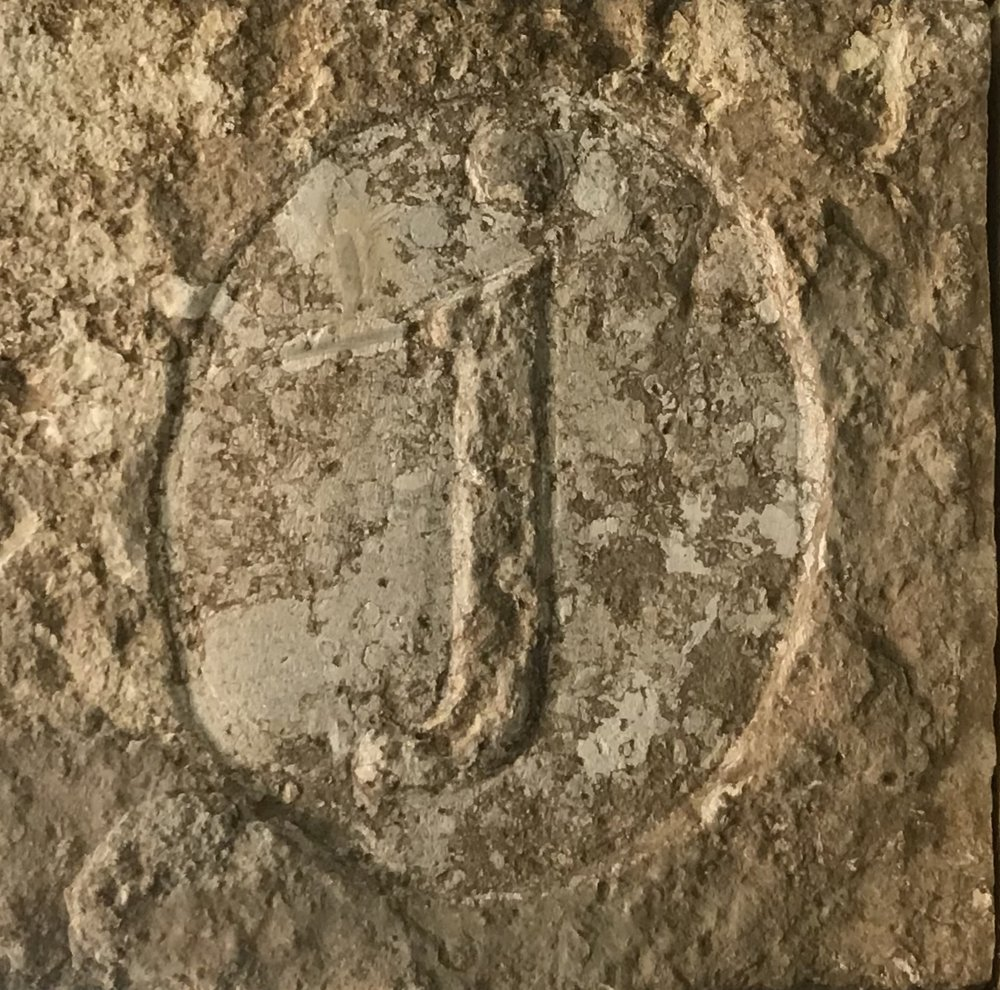 The cornerstone piece of tile at the JBar is stamped with the JBar's signature logo.