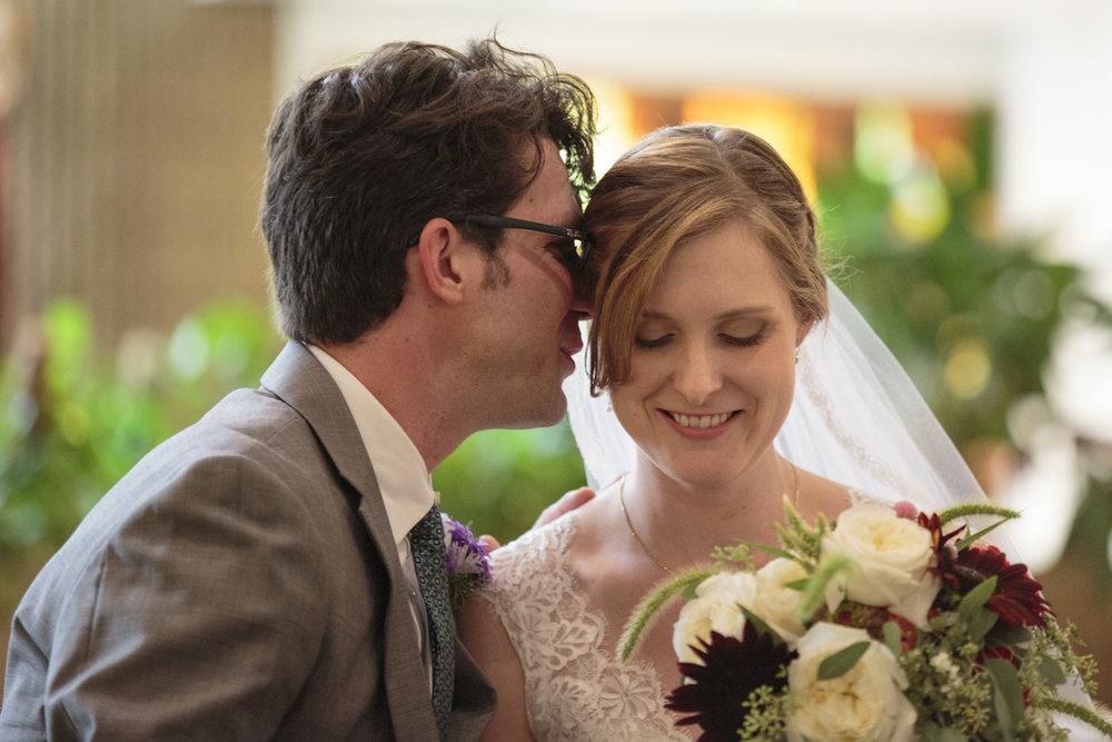 groom-whisper-bride.jpg
